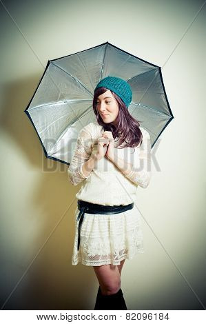Young Woman In 70S Hippie Style Posing Looking Down With Umbrella