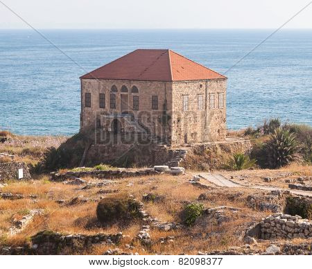 Traditional Lebanese house over the Mediterranean sea near ancient ruins Byblos Lebanon.