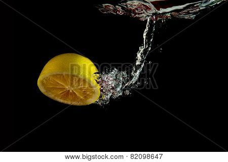 Falling Half Of Lemon Into Water