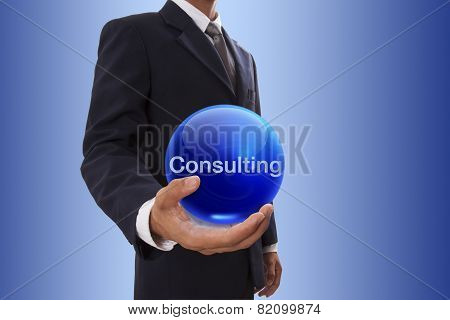 Businessman hand with consulting word.