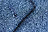 picture of lapel  - Close up detail of buttonhole on suit lapel - JPG