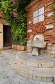 pic of bib tap  - Antique column on the street drinking Tarragona Spain - JPG