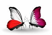 foto of qatar  - Two butterflies with flags on wings as symbol of relations Poland and Qatar - JPG