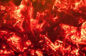 picture of ember  - Hot embers glowing from the remains of a BBQ - JPG