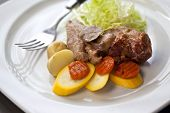 stock photo of veal  - Veal vegetable and green salad on a plate - JPG