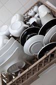 pic of dishwasher  - Plates and cups in a dishwasher in a kitchen - JPG