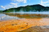 picture of steamy  - red steamy surface of the Midway Geyser Basin in Yellowstone National Park Wyoming - JPG