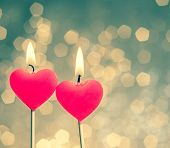 foto of candle flame  - hearts candles on vintage bokeh as background vintage style valentine day and love concept - JPG