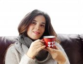 picture of glass-wool  - brunette girl with hot drink inside funny glass with hearts - JPG