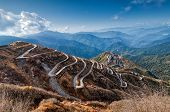 stock photo of curvy  - Beautiful Curvy roads on Old Silk Route Silk trading route between China and India Sikkim - JPG