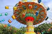 foto of carnival ride  - colorful attractions on the circuit in amusement park bottom view - JPG
