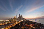 picture of dubai  - Dubai Marina Towers and Arabian Gulf coast at night - JPG