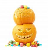 picture of jack-o-laterns-jack-o-latern  - Pile of two Jack o lantern Halloween pumpkins filled with multiple colorful sweets and candies - JPG