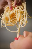 image of spaghetti  - attractive woman with eating spaghetti - JPG