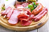 foto of cheese platter  - Catering platter with different meat and cheese products - JPG