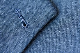 picture of lapel  - Close up detail of buttonhole on suit lapel - JPG