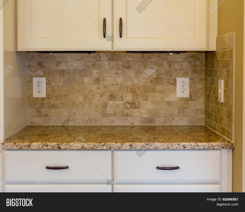 Granite counter on white cabinets stock photo stock for White stock cabinets