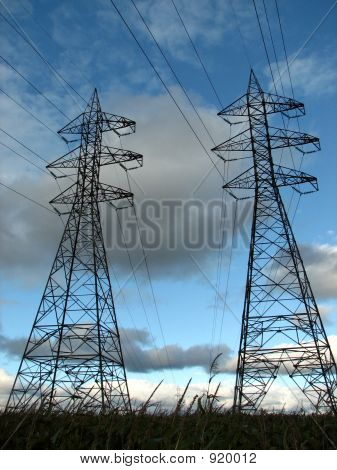 High Voltage Electric Pylons And Power Lines Against The Sky