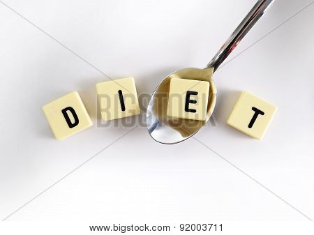 Diet Block Word In Crossword Over Sugar Pile With Spoon Taking One Letter  Isolated On Sweet Grainy