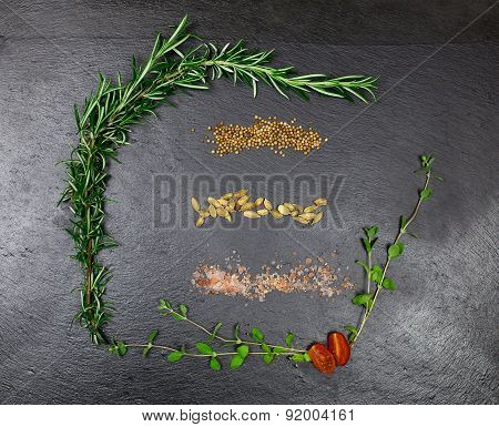 Aromatic Herbs And Spices Over Black Slate Sheet