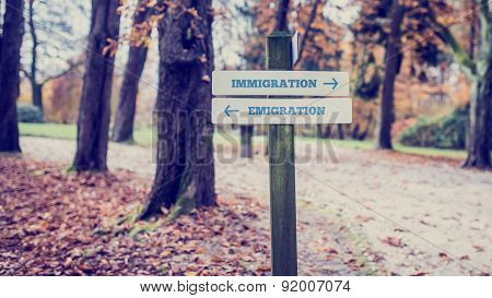 Signpost For Immigration And Emigration Concept