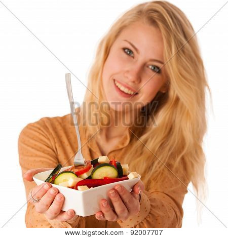Beautiful Young Caucasian Blonde Woman Eats A Delicious  Salad As A Sign For Healthy Eating Isolated