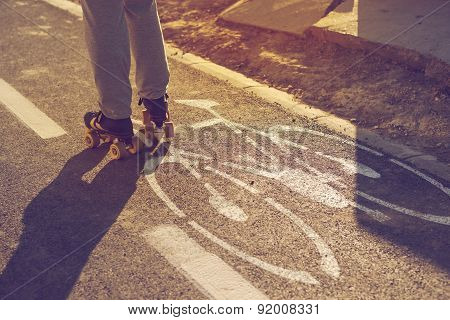 Woman Riding Roller Skates In Urban Environment