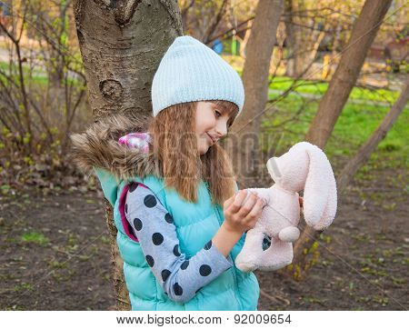 Little girl with a toy hare
