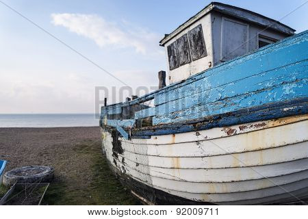 Abandoned Fishing Boat Ruin On Beach During Lovely Summer Morning