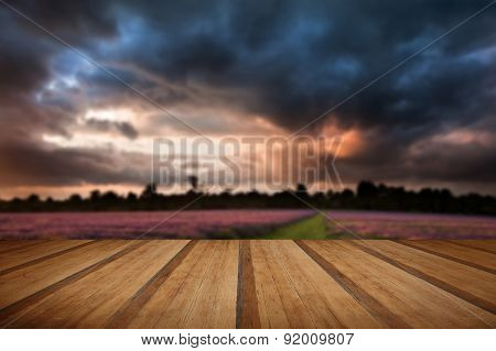 Beautiful Vibrant Colorful Summer Sunest Over Lavender Field With Wooden Planks Floor