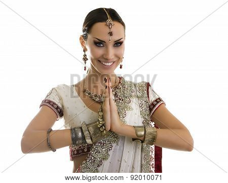 Beautiful Indian Woman In Traditional Sari Clothing With Bridal Makeup And Oriental Jewelry. Namaste