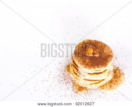 isolated desert - stack of pancake with cocoa and nut