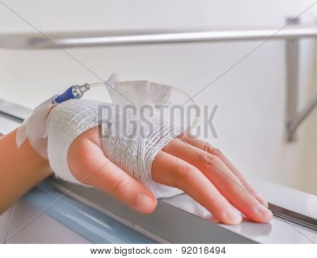 Child's Hand Who Fever Patients Have Iv Tube.