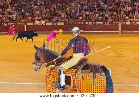 MADRID, SPAIN - SEPTEMBER 18: Matador and bull in bullfight on September 18, 2011 in Madrid, Spain.