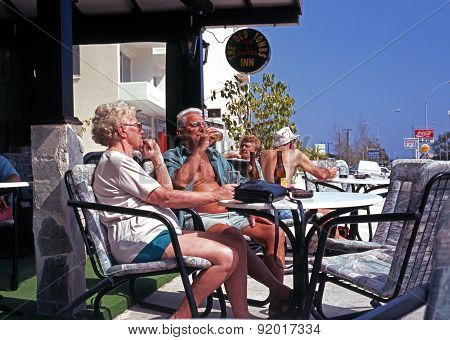 Elderly couple at bar, Limassol.