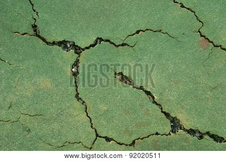 Cracked tennis court surface