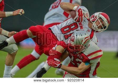 GRAZ, AUSTRIA - MAY 31, 2014: WR Jonas Bo Hansen (#81 Denmark) is tackled by DB Matthias Rebl (#22 Austria).