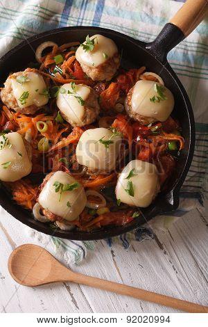 Meatballs With Mozzarella Closeup In A Pan. Vertical Top View