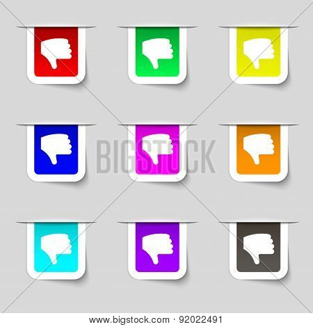 Dislike, Thumb Down, Hand Finger Down Icon Sign. Set Of Multicolored Modern Labels For Your Design.
