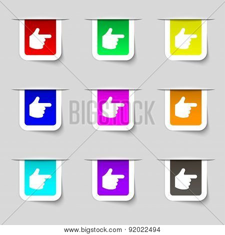 Pointing Hand Icon Sign. Set Of Multicolored Modern Labels For Your Design. Vector