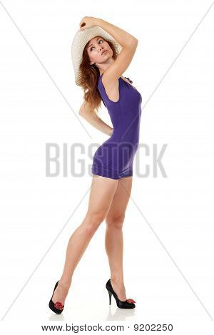 Girl In Sexy Dress With A Hat