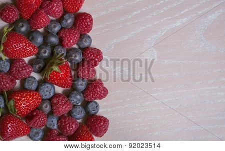 Different Fruits On The Wooden Background