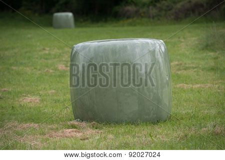 Bale Of Straw Into Plastic