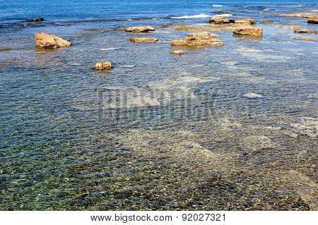 Wild Seascape With Low Tide And Surfacing Rocks