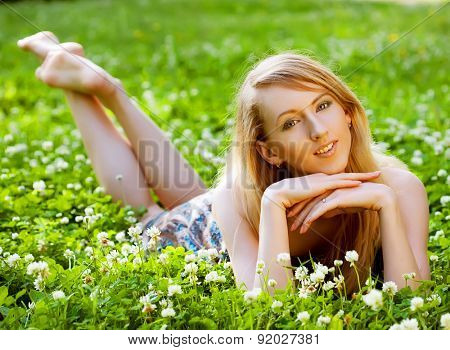 young Woman relaxing outdoors smiling