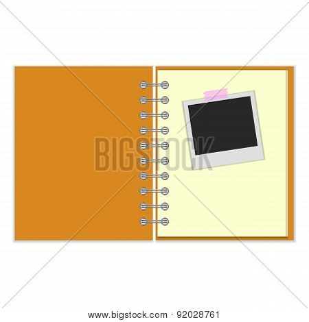Open notebook with photo