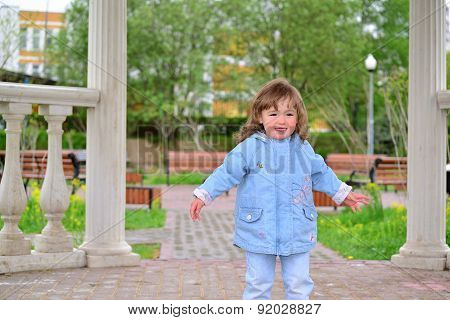 Cute Baby Girl With Blonde Curly Hair Outdoors.  2-3 Year Old.