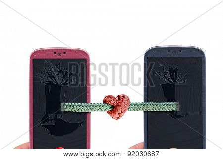 Blue and pink smartphones and rope with tied knot with a heart shape coming out from a broken glass and lcd . Idea for Valentines Day messages, love, lovers, love apps, Internet, blogs and others.