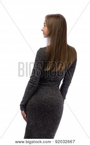Girl In A Gray Dress From The Back