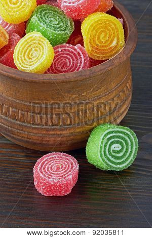 Sweet colorful candy on wooden background